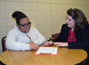 School Age Girl Speaks with Admissions Counselor