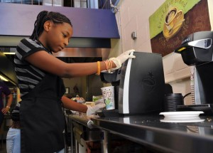 MSB Female Student Makes Coffee in Rock-N-Roll Cafe