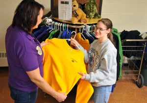 Girl Assists Shop Staff at The Clothes Pole - A Resale Shop at MSB