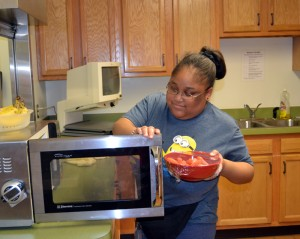 MSB female student cooks with microwave