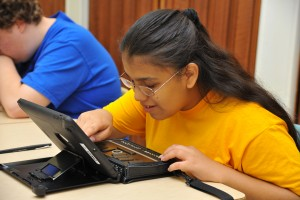 Girl Uses Assistive Technology in the Classroom