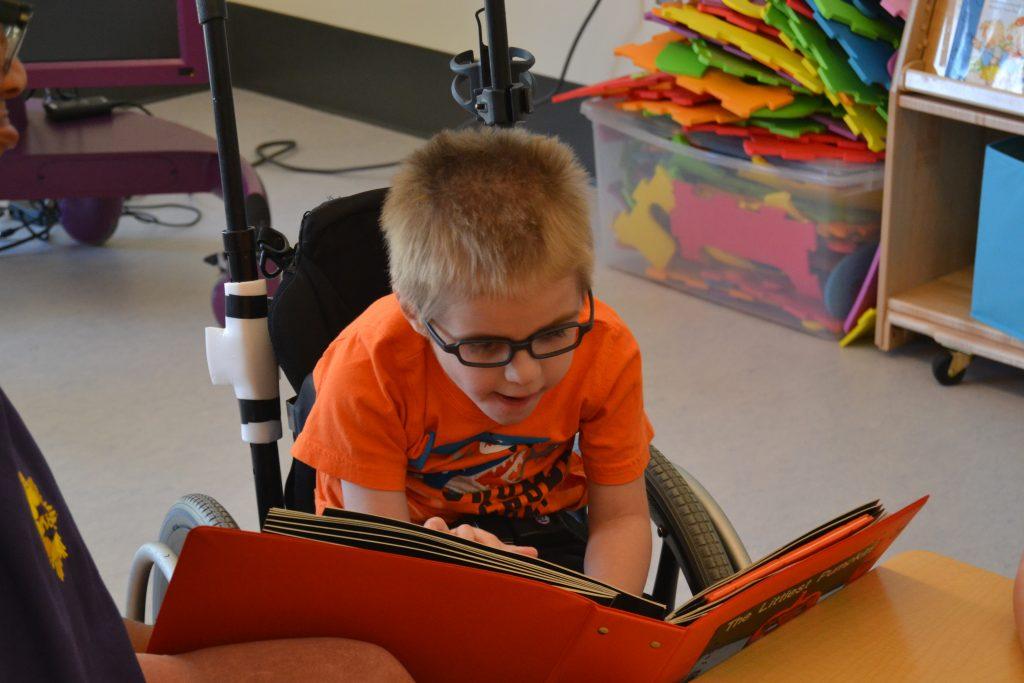 Sam enjoying a pumpkin book